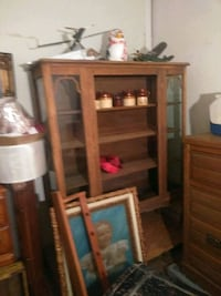 This is a very very old solid oak China cabinet.  369 mi