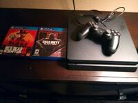 black Sony PS4 with controller and game cases Ocala, 34471