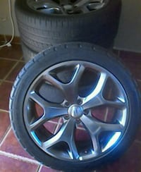 chrome 5-spoke car wheel with tire Dodge charger