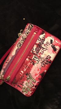 """Real coach wristlet - like new - bought it for $200"""""""