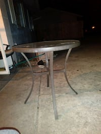 round black metal framed glass top table Orlando, 32825