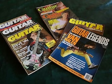 assorted guitar themed magazines