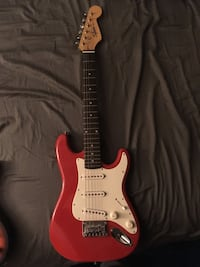 Red and white electric guitar Meriden, 06451