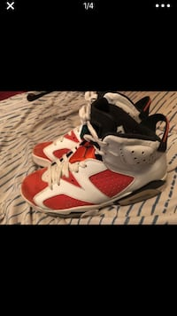 pair of white-and-red Air Jordan shoes Houston, 77020