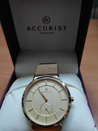 Reloj Marca: Accurist London, chapado en oro puro.
