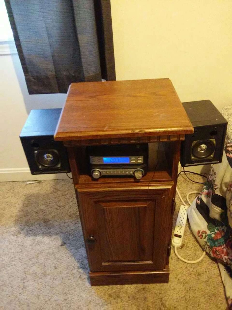 black and gray digital stereo with two corded speakers