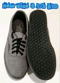 pair of gray Vans low-top sneakers 2056 mi