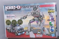 Hasbro KRE-O Transformers Megatron Construction Set (30688)-310PCS  Brand new in the box, never opened, box has some of the picture ripped off.  Doesn't affect the toy.    Build the ultimate Decepticon villain, Megatron, in vehicle or robot mode with this Vaughan