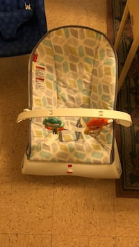 baby's gray and teal bouncer