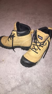 pair of brown-and-black work boots. Size 8 but fits big   Brampton, L6Y