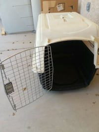 white and black pet carrier Yuma