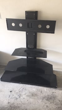 Black glass tv stand with mount attached to it  Fort Smith, 72904
