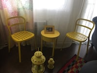 1 yellow round tables and 2 yellow chair and 2 Candle Mississauga
