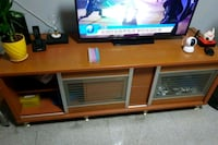 brown wooden framed glass top TV stand Singapore