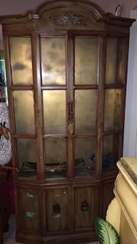 Brown wooden framed glass display cabinet Lauderdale Lakes, 33311