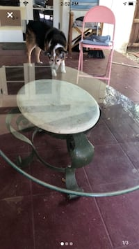 Cute oval glass coffee table.