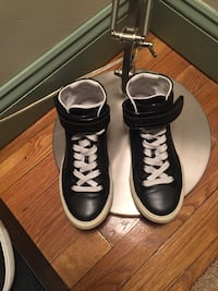 Pair of black leather high-top sneakers
