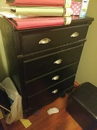 black wooden 4-drawer chest