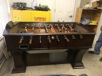 Brown wooden foosball table