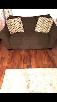Brown fabric living room set with throw pillows ...loveseat has a sleeper inside