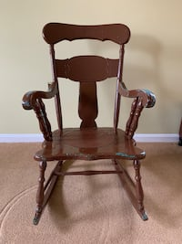 brown wooden rocking chair with brown wooden frame