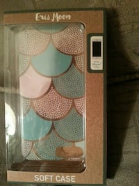teal and white Eris Moon iPhone case with box