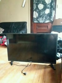 black flat screen TV with black wooden TV stand Schenectady, 12303