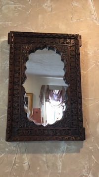 """Mirror,21"""" tall by 15"""" wide. It's wood"""