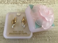 14 KT gold earrings with freshwater pearls. Comes in an adorable pink box with delicate flower. Never worn Potomac, 20854