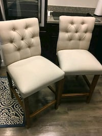 two white padded chairs with brown wooden frame Revere, 02151