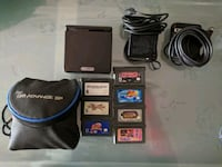 black Nintendo DS with game cartridges Coquitlam, V3K 1P7