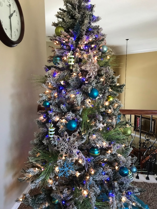 Used 7.5 ft pre lit Christmas tree with faux snow for sale in McKinney