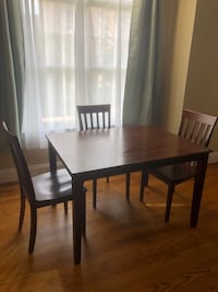 rectangular brown wooden table with four chairs dining set Arlington, 22202