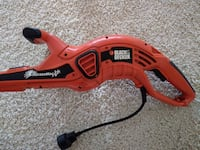 orange and black Black & Decker hedge trimmer Temecula
