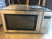 stainless steel and black microwave oven Colorado Springs, 80917