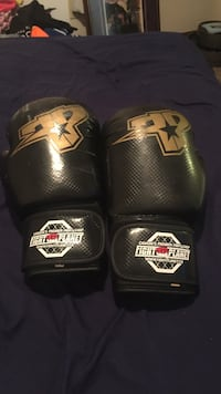 pair of black Fight Planet boxing gloves