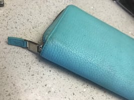 Authentic Tiffany & Co zip around wallet < good condition