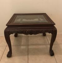 """Vintage decorative all wood end table/w glass insert. 21"""" tall, 28"""" long 24"""" wide Port Charlotte, 33954"""