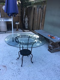 Glass top round table with iron base