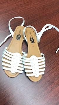 pair of brown-and-white leather strappy flat sandals