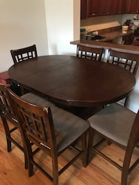 Need to sell ASAP ! solid wood  Dining table and chairs - with removable center Newark, 07104
