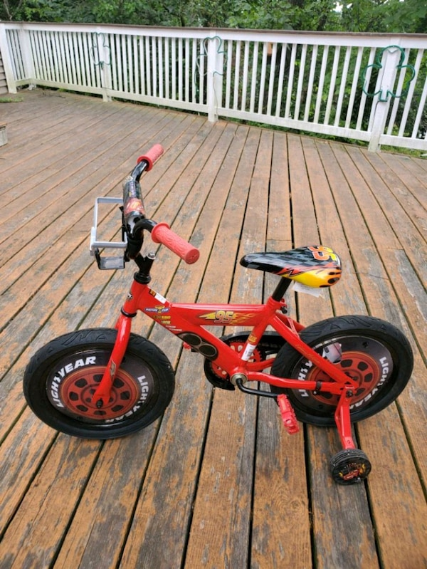 Kids lighting McQueen bike