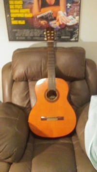 brown and black acoustic guitar Calgary, T2A 2G7
