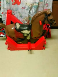 red and brown rocking horse