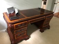 brown wooden single pedestal desk Reston, 20194