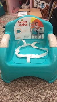 baby's teal and white Bumbo floor seat Carson, 90745
