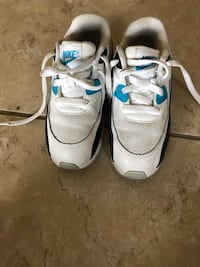 pair of white-and-blue Nike running shoes Orlando, 32824
