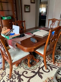 brown wooden dining table set 57 km
