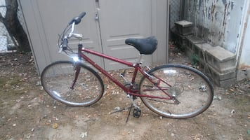 Red MONGOOSE 27-Inch Man's Bicycle.