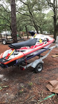 red and white personal watercraft Navarre, 32566